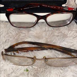 2pair of Versace glasses.